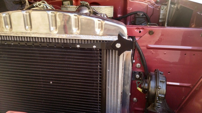1957 Chevy inside shows right side mount of radiator