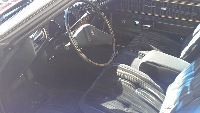 1977 Oldsmobile Cutass Supreme inside view of front seat