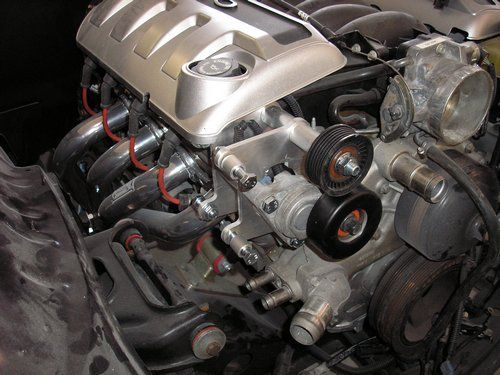 2004 LS1 GTO motor showing headers, motor mount kit and AC relocation bracket