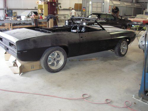 Dynacorn convertible body 1969 Camero passenger side view. Mocking up body panels for proper fit.