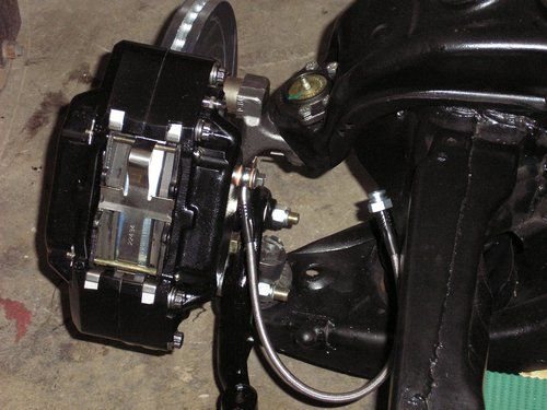 2004 LS1 GTO motor and 69 Camero sub-frame showing stainless steel front disk brake setup.