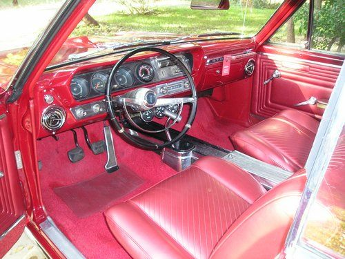 1965 pontiac gto, inside front seat and dash from driver side