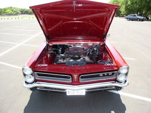 1965 pontiac gto, front view, hood open, engine visible