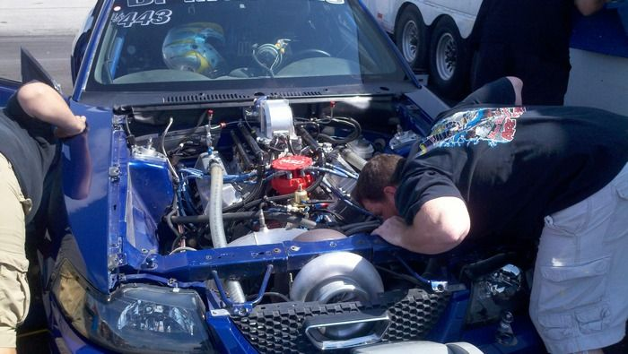 1969 Ford Mustang Mach 1 Twin Turbo Hemi working on the engine
