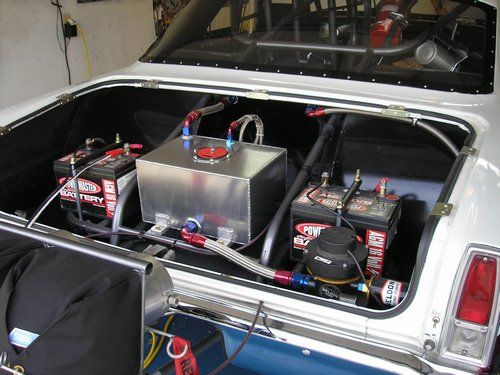 Outlaw 1966 Nova, inside trunk showing fuel cell, monster fuel pump and batteries.