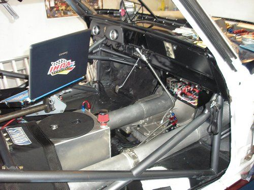 Outlaw 1966 Nova, inside of car showing laptop and cooling chamber.