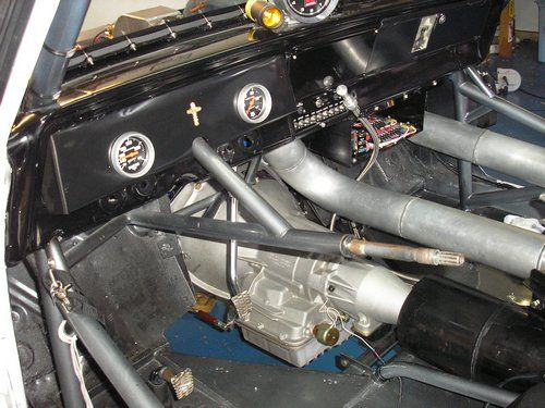 Outlaw 1966 Nova, inside view showing power glide trans.
