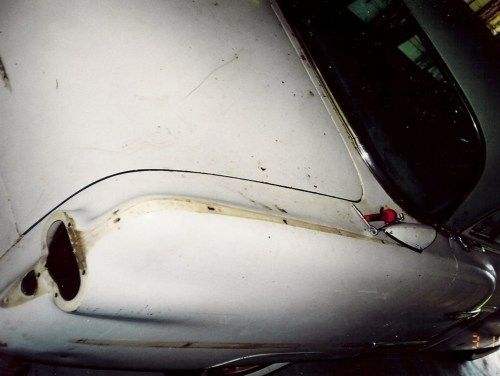 rear fender and trunk lid, 1954 Packard Patrician, shows original condition of the paint